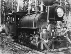 [Railroad engine, crew, and logs]