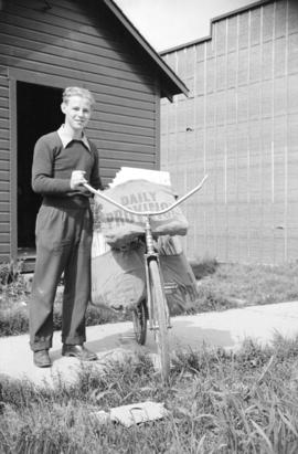 [Province newspaper delivery boy with bicycle]