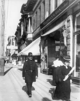 [A policeman in the 700 Block of Granville Street]