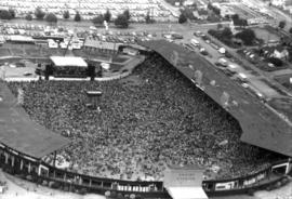 Aerial view of crowd at outdoor concert in Empire Stadium