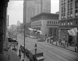 [View of Hastings Street showing flags and banners hanging across the street as part of VE and VJ...