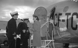 [Vice Admiral Percy W. Nelles being admitted to Trans Canada airlines plane by a stewardess]