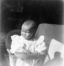 [Theodore Taylor sitting in high chair at age] 13 mo[nths]