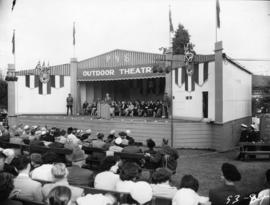 A.E. (Dal) Grauer, president of B.C. Electric Co., giving speech on Outdoor Theatre stage at 1953...