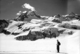 Skier looking at Mount Garibaldi from Garibaldi Neve (Glacier)