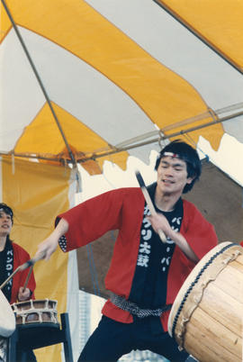Paul Yee playing taiko drums