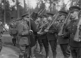 Lord Byng visit - military inspection of men in uniform with rifles