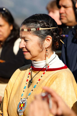 Woman at flame creation ceremony