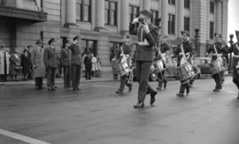 [Air cadet marching band being reviewed in front of the C.N.R. Station]