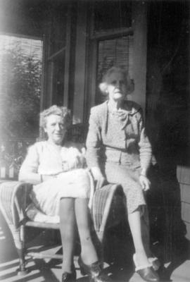 Marian Lindgren , nee Hines (right) with Florrie Wilson [left] on the porch of 3500 Willow Street...