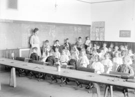 [Teacher Dorothy Allison and students in classroom of Model School]