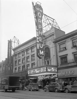 "[Exterior view of the Orpheum Theatre with advertising for the movie ""Lady Luck""]"