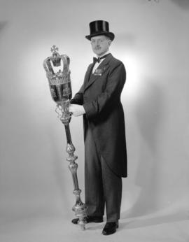 [Full length portrait of Peter Heath, Sergeant-at-Arms, with the City's ceremonial mace]