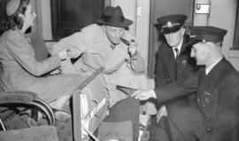 [Jack Benny and Mary watching customs officers check their baggage]