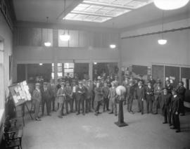 [Group of men assembled inside Vancouver Merchants' Exchange building at 815 West Hastings S...