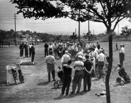 Unidentified speaker and audience on golf course in Exhibition Park
