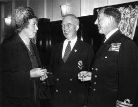 P.N.E. Vice-President J.S.C. Moffitt and unidentified woman with Royal Navy commander