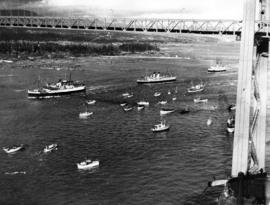 [Flotilla escorting King George VI and Queen Elizabeth under the Lions Gate Bridge]