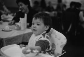 Boy in high chair