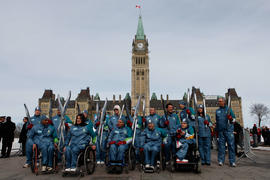 Day 1 Paralympic torchbearers pose in front of Parliament Hill, Ottawa, Ont.