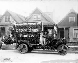 [Brown Bros.' van decorated for a parade]