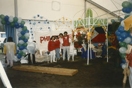 Group in front of Philippines banner in Heritage Showcase tent
