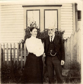 [Unidentified woman and Alexander Price standing in front of 502 Alexander Street]