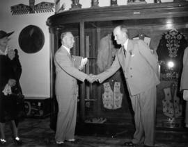 V.E.A. President J. Dunsmuir shaking hands with Vancouver Mayor J.W. Cornett