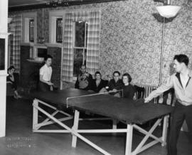 [Visitors playing ping-pong at the Bowen Island Resort]