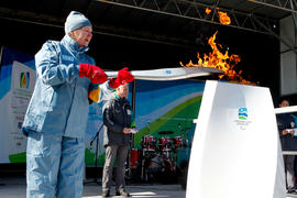 Torchbearer 22  Bonnie Friesen lights the Paralympic cauldron in Riley Park, BC