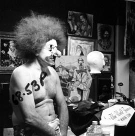 Clown applying makeup