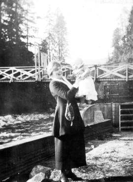 [Woman holding baby by the Capilano River]