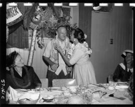 "P.N.E. President W.J. Borrie dressed as ""Beachcomber Bill"" with ladies at party"