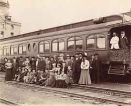 [An unidentified group in front of a C.P.R. observation car]