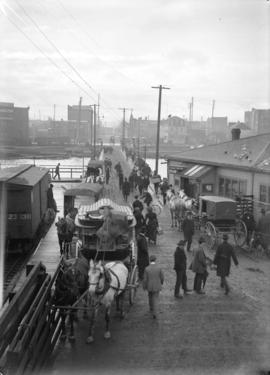 [People and carriages waiting for ferry at Evans, Coleman and Evans dock]