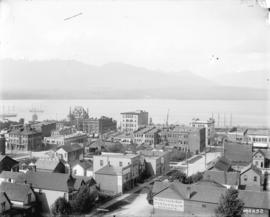 [View of downtown buildings, Burrard Inlet and North Shore mountains, looking north from the roof...