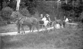 [Family in two horse drawn carriages at Stanley Park]