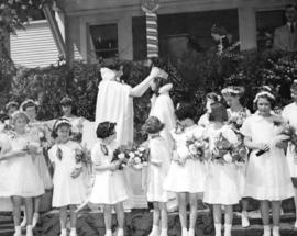 [The May Queen is crowned outside Brock School]