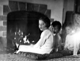 [Jane Banfield, John Banfield and Alix Louise Gordon] before the fire