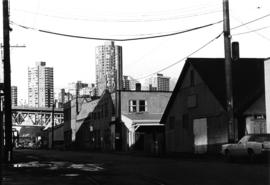 Granville Island, row of buildings with West End towers in background