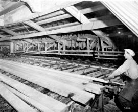 "[Interior of sawmill showing ""cut-off"" saws]"