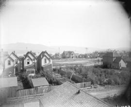 [View of houses on Alberni Street, empty lot, and partially constructed Christ Church Cathedral]