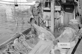 [Man on fishing boat]