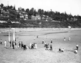 [Men, women, and children on beach at] Whiterock