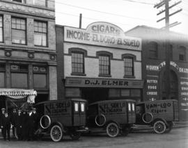 D.J. Elmer Wholesale Tobacconist, 27 Pender Street West, delivery trucks and staff in front of wa...
