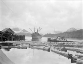 "[The ""Camosun"" approaching] Pacific Mills [dock on the] Queen Charlotte Islands"