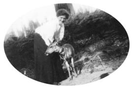 Adella Barwis Dorais with a young fawn, as I called the log cabin Ma Caban