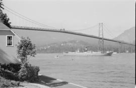 [View from Brockton Point of freighter passing under the Lions Gate Bridge]