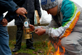 Lighting a Paralympic lantern