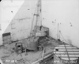 Liquid sugar station construction of moving upper section of first tank and placing coils in bott...